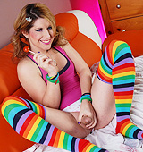 Amy and her striped stockings. Pleasant Amy posing her cock while give suck a lollipop